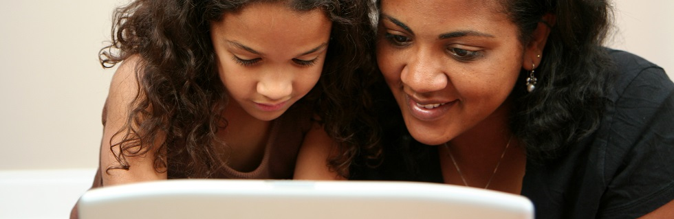 Parent and child sharing online learning activities